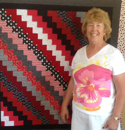 Another happy customer holding a quote done by Susan K. Quilting