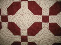 Rochelle's Red and Beige Swirls Quilt
