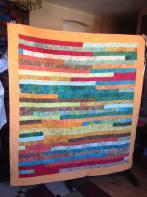 Val's Orange Strip Quilt