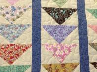 Loretta's Scrappy Flying Geese Quilt